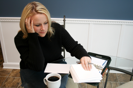 A young woman gets tired writing