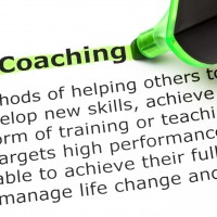 Definition of the word Coaching, highlighted with green text marker.